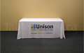 Custom printed 6 foot table throw with multi colour logo dye sub printed on the front